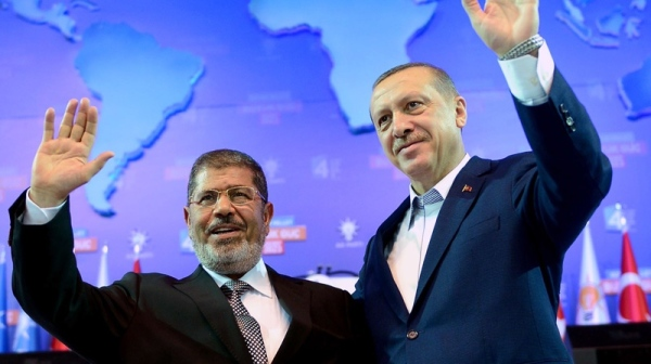 Down with secularism: Muslim Brotherhood backed leaders Mohammed Morsi and Recep Erdogan have been among the most vocal supporters of regime change in Syria, and the ultra-sectarian Brotherhood stands most to gain from the fall of the Ba'athist government.
